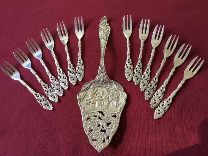 Silver plated open work cake slice with old Dutch scene and 12 open work cake forks with bird and flowers