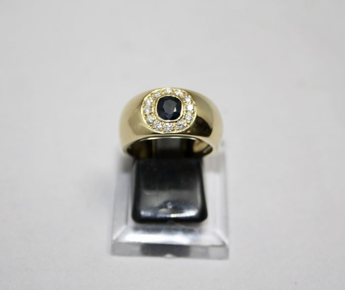 Ring in 18 kt yellow gold with 0.60 ct sapphire and 0.36 ct diamonds, size 55