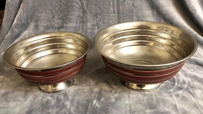 A set of two , elegant , table bowls , made in Silver Plated and with embedded decoration of genuine leather
