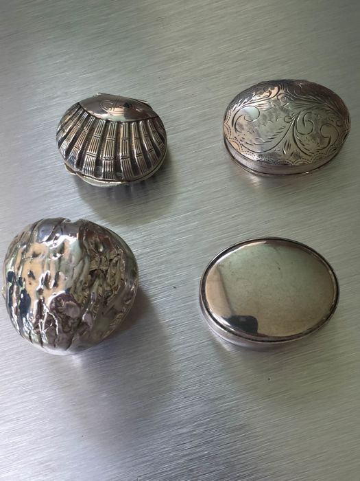 Lot of four silver pill boxes