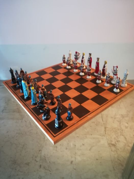 Hand painted pewter chess pieces with board in marine wood