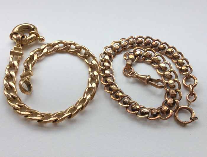 2 Marked watch chains in a gold colour.