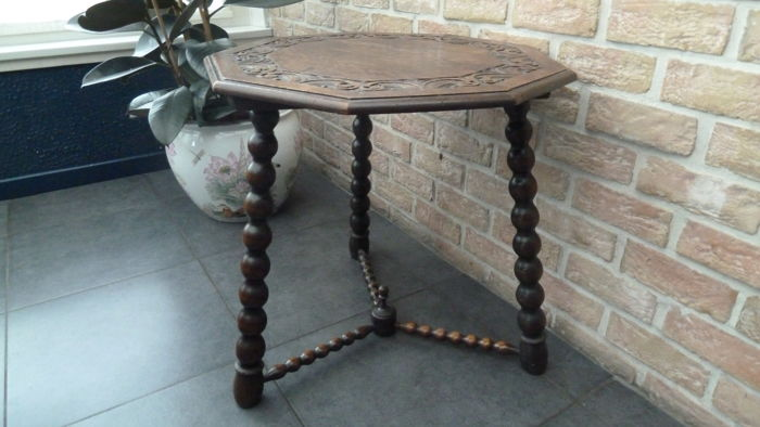 Nine-angular side or coffee table, with carved table top and bobbin turned legs - early 20th century