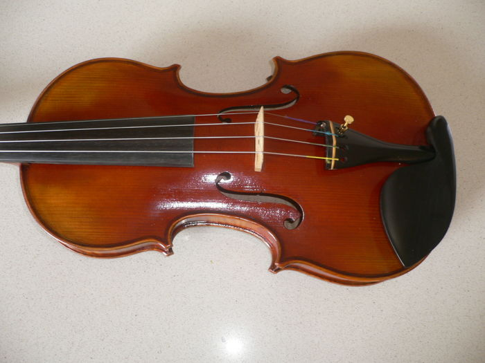 Presumably 4/4 German violin, beautifully finished, one-piece back, full tone