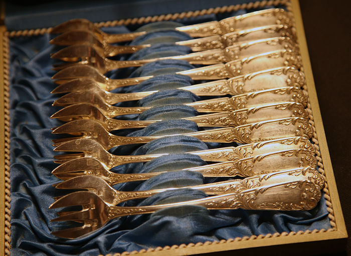 12 silver plated oyster forks in original chest