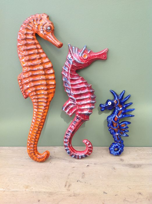 Beautiful wall decoration with three seahorses in earthenware