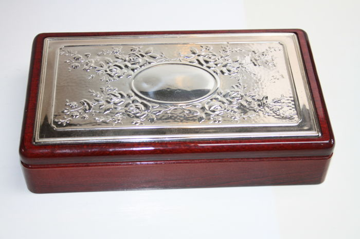 Wooden jewellery box with silver lid