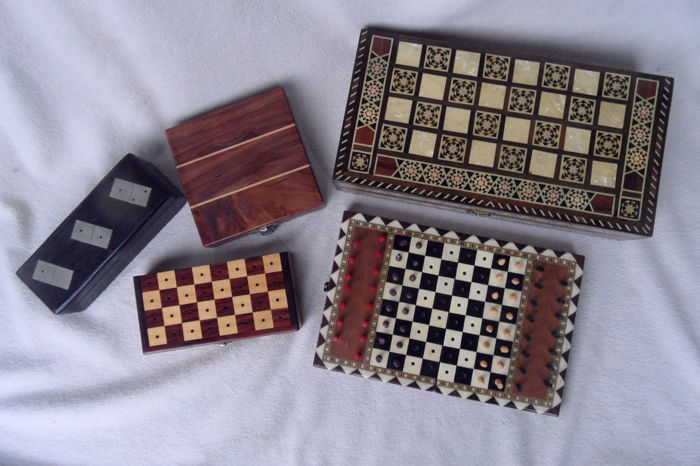Collection of board games and domino in deluxe wooden storage boxes