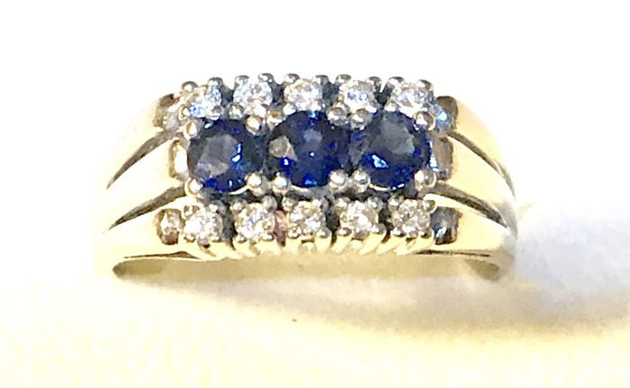 White gold ring with 10 real diamonds 0.24 carat and 3 natural sapphires 0.6 carat