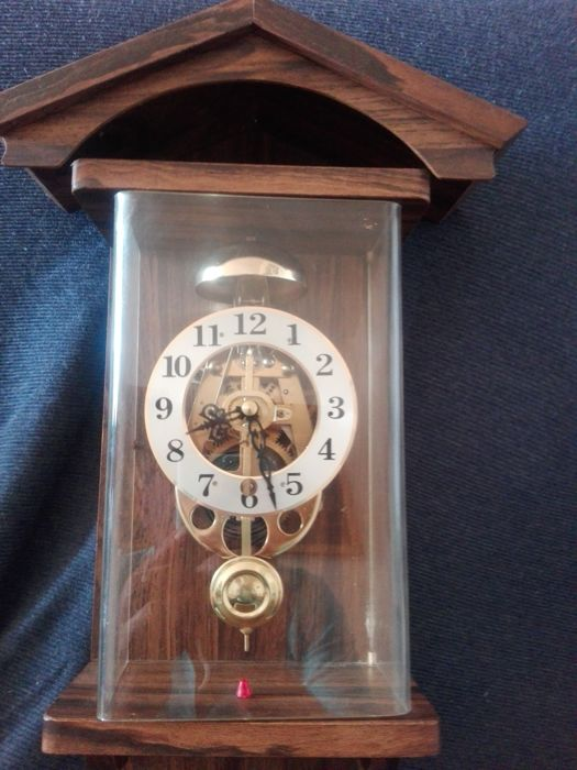 Pendulum wall clock, anonymous, with visible mechanism