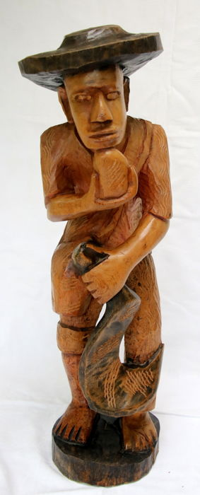 Beautiful wooden statue carved from one piece of wood Height 60 cm