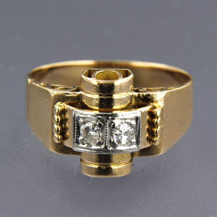 18 kt bicolour gold ring set with 2 single cut diamonds of approx. 0.10 ct in total