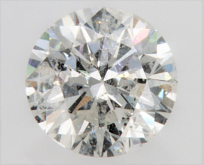 Round Brilliant Cut  - 0.76 carat - F color - SI1 clarity- 3 x EX - Comes With AIG Certificate + Laser Inscription On Girdle.