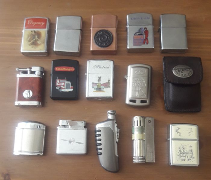 Lot of 14 vintage lighters: Zippo, Spirit of St. Louis, Imco Triplex, Laguiole, Champ