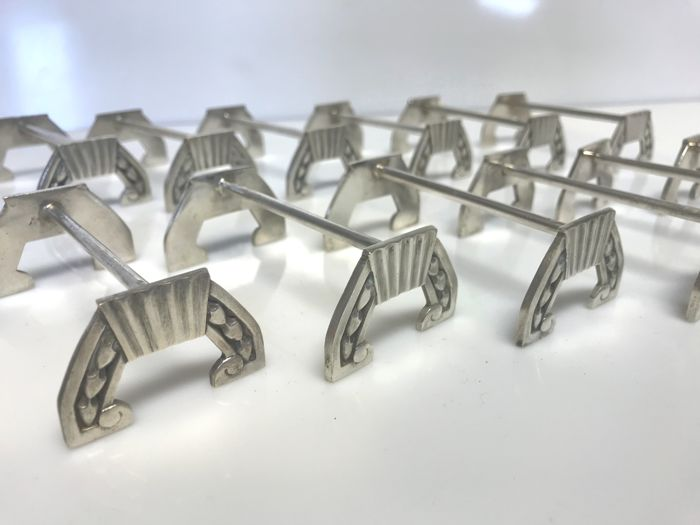 Christofle, 12 knife rests for the table, circa 1950 (silver plated metal)