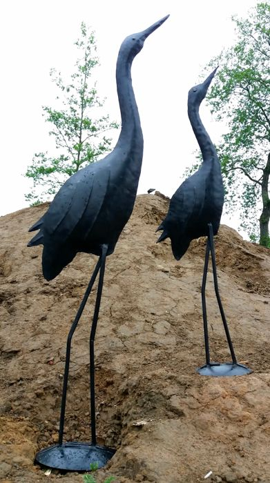 Two very large metal birds - iron cranes