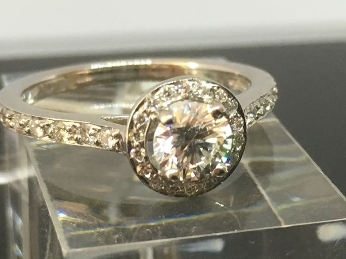 Platinium Engagement Ring with Diamond (0.50ct each) set off with more Diamonds.