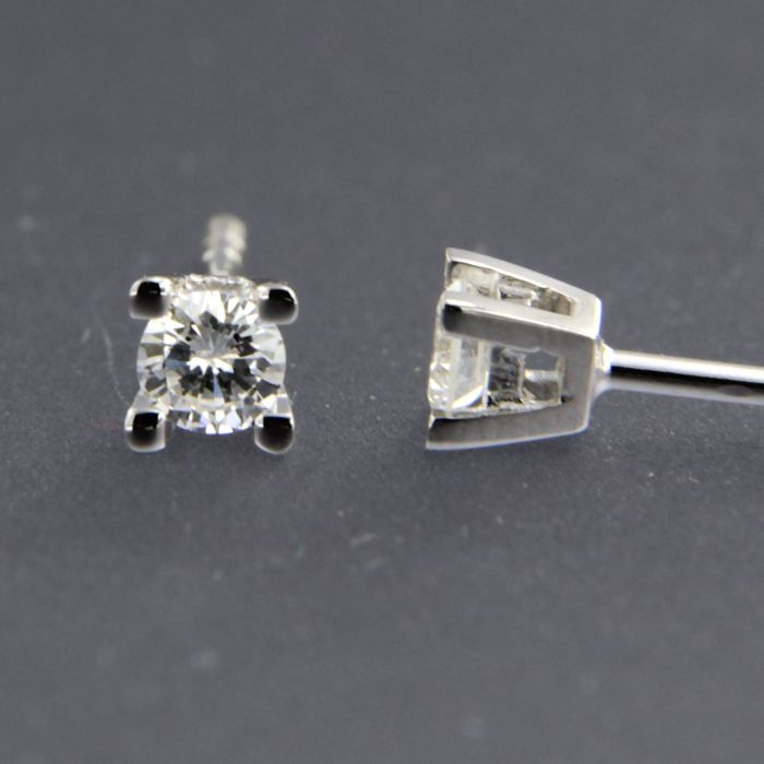 14 kt white gold solitaire ear studs set with brilliant cut diamond of approx. 0.20 ct in total - size 3.7 mm wide