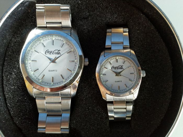 A pair of Coca-Cola watches - for men and women