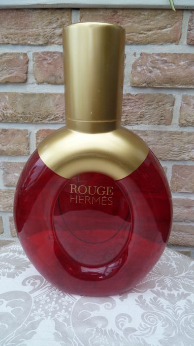 Large advertising bottle of scent ROUGE by HERMES