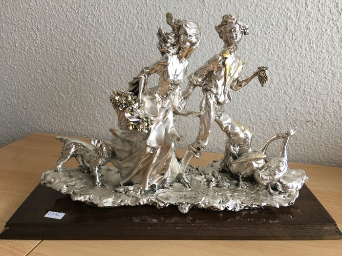 Gorgeous large silver Sculpture. Appraised by an expert. Lovers out for a walk with animals. Circa 1990