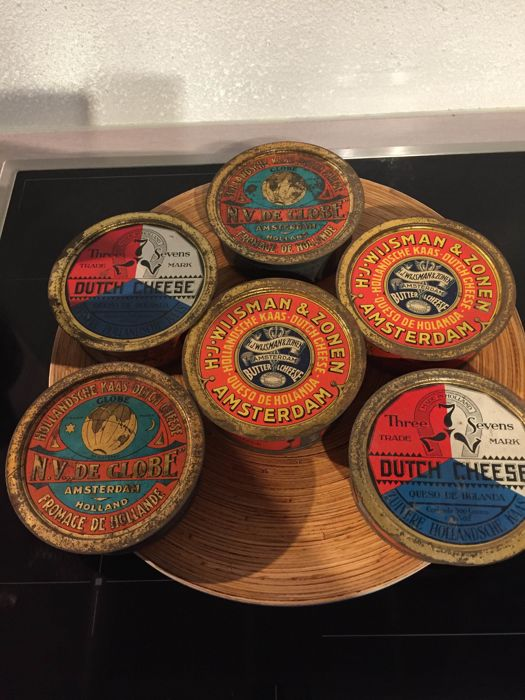 Six very old cheese tins