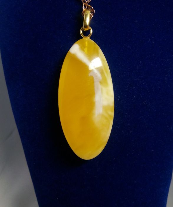 Antique Amber pendant in egg yolk and royal white colour and German silver with gold-plated, 6.2 grams