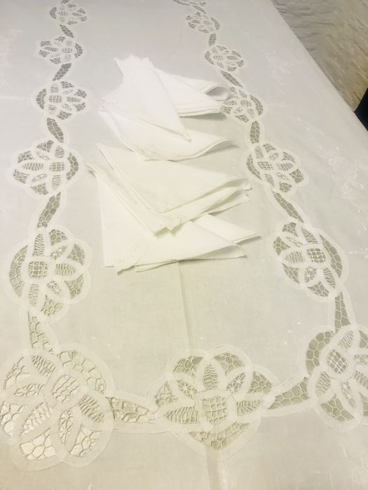 Tablecloth in pure linen from trousseau. 262 x 170 cm, with rich Renaissance ribbon embroidery