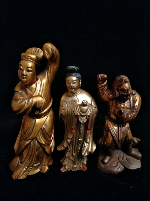 3 statues of immortals in gilded wood, China, 19th century