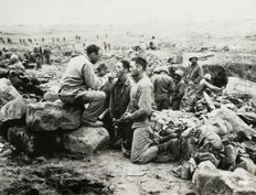 Unknown/ACME  - US soldiers take Holy communion on the battlefield, c.1940's / 'Taps for Okinawa fighters', Japan, 1945