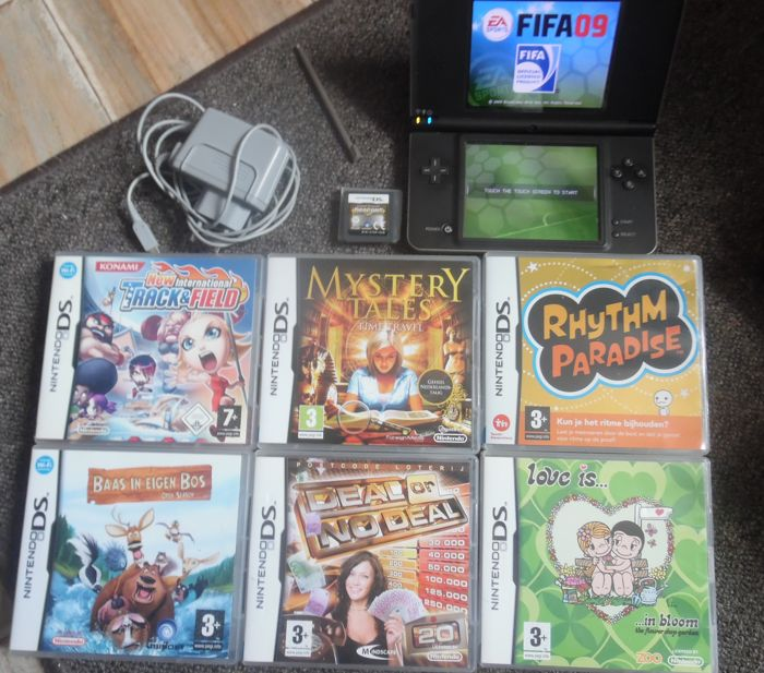 Dsi XL +  7 games and charger.