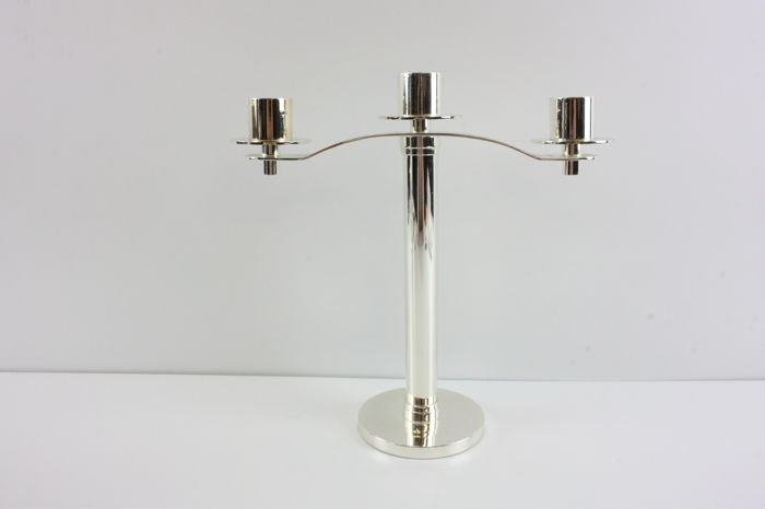 Silver plated modern and sleek candle stick / three candles.