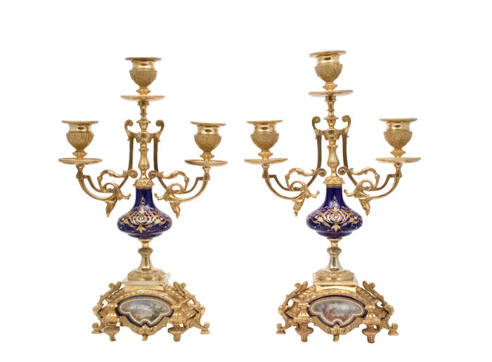 A pair of excellent gilt metal mounted Sevres style porcelain candelabra with pictorial landscape panels - France - late 19th century