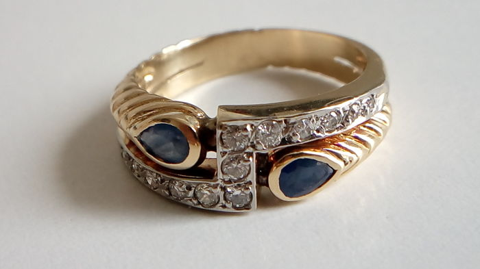 Ring in 18 kt yellow gold, with diamonds and sapphires