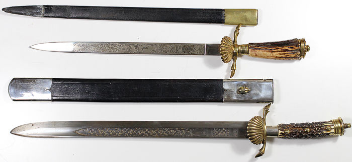 Two German hunting swords / daggers / Hirschfangers in scabbard