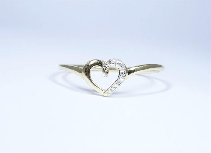 Ring in 18 kt gold of 1.0 g set with diamonds - no reserve price