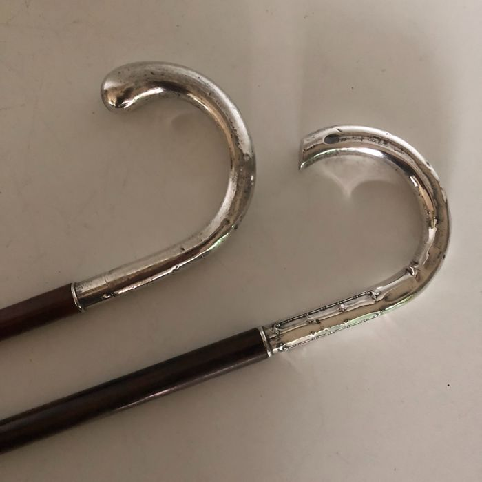 Two wooden canes with marked Silver handle, Italy