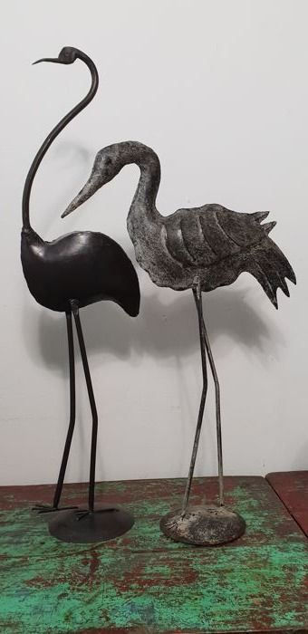 Two large (68 cm and 54.5 cm) handmade metal bird sculptures