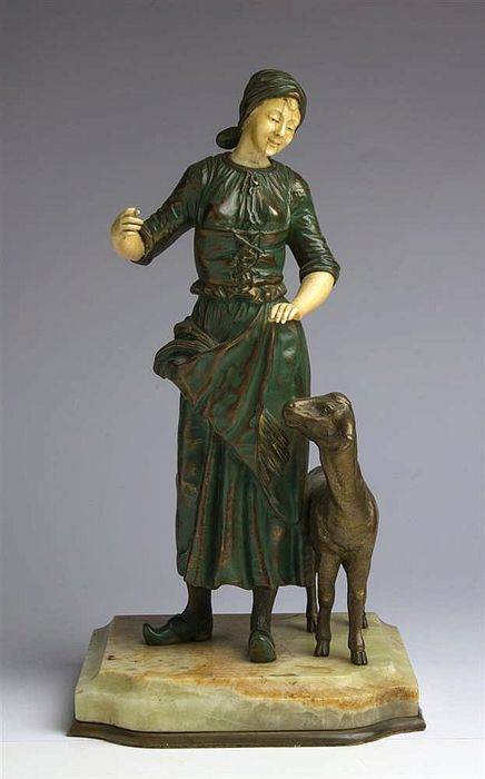 Georges Omerth (active 1895-1925) - bronze and ivory sculpture of a shepherdess with sheep - France - early 20th century