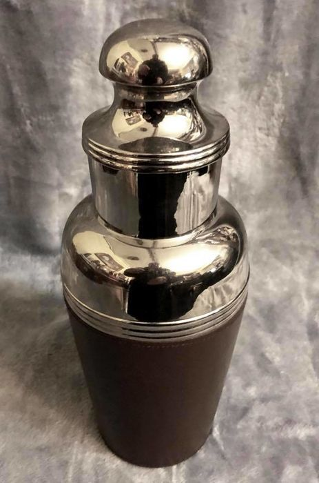 A , high quality , elegant , Silver Plated , and , genuine leather covered , heavy , cocktail shaker  , never born