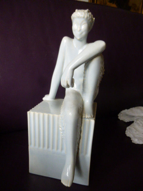 Imp holding a book - ceramic in the spirit of Clodion