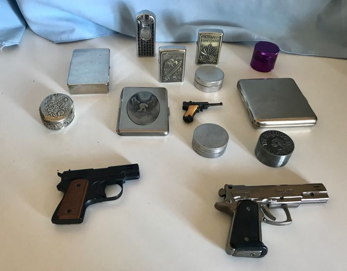Smoking Accessories: Three Silver Cigarette Boxes - Three Gun Refillable Gas Lighters - Gas lighter EuroJet - Three Grinder for Cbd - Two gas lighters similar to Zippo