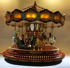Festival luxury carousel with animals Very large and illuminated
