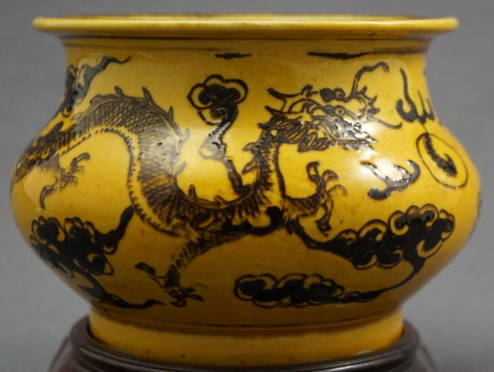 Tall incense burner with a scenery of two dragons in a fiery field of clouds with pearl - China - circa 1900