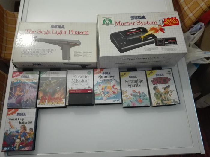 Sega Master System II , in original box with 7 games and Sega Light Phaser(in original box with  manual)