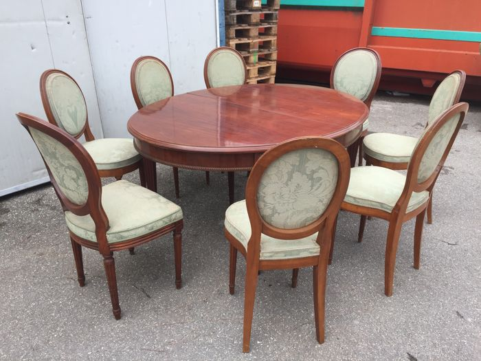 Extendable oval dining table in solid mahogany, 12 seats with 6+2 chairs, in Louis XVI style, 20th century