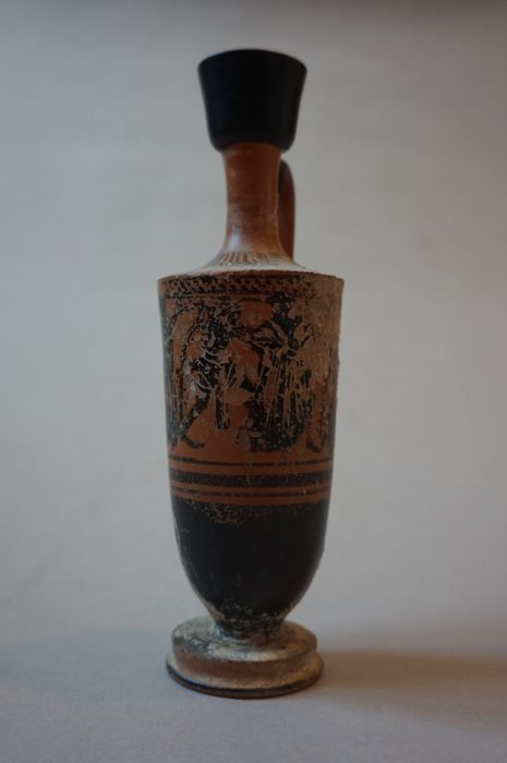 Lecythus with decoration of black figures, 17.5 cm high