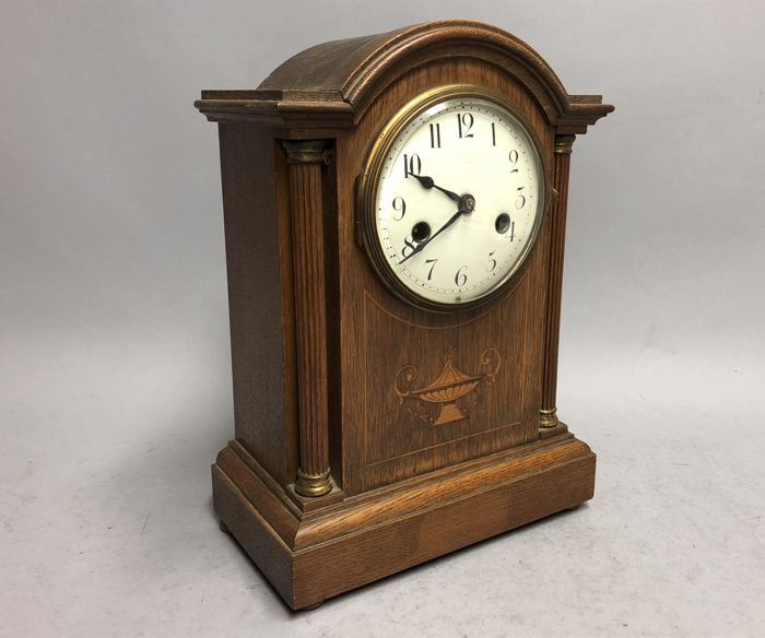Wooden table clock with striking mechanism and intarsia at the front - period 1920