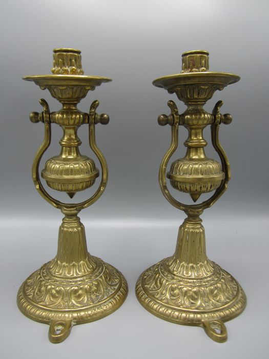 A pair of ship's candlesticks