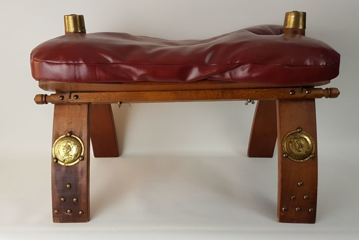 Camel saddle - a bench/stool with a leather seat and footrests
